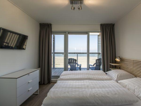 zeezicht-slaapkamer-beach-villa